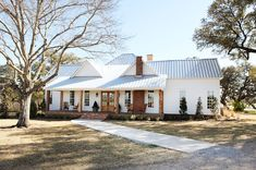 FTER: The old rear facade is now the front entry, dressed up with a new porch. When the Gaineses reoriented the entry, a lot of the old wind...