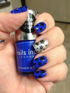 Navy & silver nails with black stars.