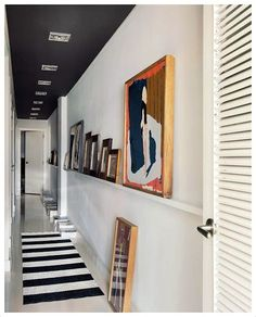 Long narrow hallway with black ceiling and pictures on a flat shelf . Long narrow hallway with black ceiling and pictures on a flat shelf Hallway Ceiling, Hallway Wall Decor, Hallway Walls, Black Hallway, Entryway Decor, Entryway Lighting, Entryway Ideas, Hallway Shelf, Hotel Hallway