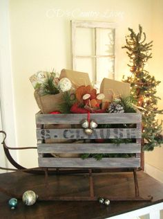 I'm sharing how I turned a store bought crate into a vintage sleigh for the…