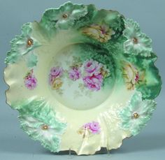 """RS Prussia Large Bowl, 14.75""""d.; Mold 28, Carnation, FD 20, roses on white to cream ground with pink and yellowroses around wall, blue green accents with ghost flowers and leaves, blue and gold highlights to mold features at rim"""