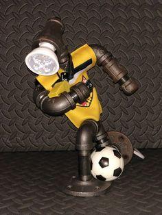 Soccer Player | steampunk sportz custom lighting Pipe Lighting, Custom Lighting, Lighting Design, Galvanized Decor, Pipe Decor, Diy Pipe, Pipe Lamp, Pipe Furniture, Rustic Style