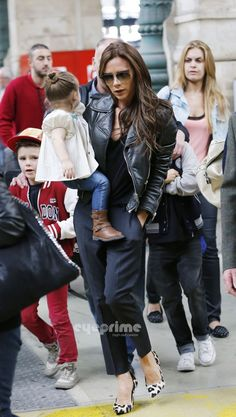 Victoria Beckham seen shopping with her kids in Paris on May 18, 2013