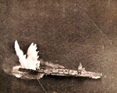 """Japanese cruiser hit by tin fish from Navy """"Avenger"""" torpedo bomber operating in the Marshall Islands area. Photographed by the Steichen Photograph Unit, Commander E. J. Steichen, December 7, 1943: TR-8387. Official U.S. Navy Photograph, now in the collections of the National Archives."""
