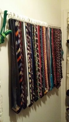 Necktie organization for under $6. Curtain rod from Walmart = $.97. Shower curtain rings from Walmart = $.97 for 12. I have a lot of neckties. I also did another row for my girlfriend's scarves. #necktie #organization