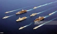 Naval vessels from five nations (L-R) ITS Maestrale, FS De Grasse, USS John C. Stennis, USS Port Royal, FS Charles de Gaulle, HMS Ocean, FS Surcouf, USS John F. Kennedy, HNLMS Van Amstel and ITS Luigi Durand de la Penne fall into position for a rare photographic opportunity in this undated photo. The coalition forces are deployed supporting Operation Enduring Freedom.