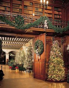 Christmas at Biltmore House in Ashville, North Carolina. Tall trees line the halls of the Tapestry Gallery. As guests enter the Library a warm glow from the rooms large fireplace is cast upon the bookshelves and the Pellegrini ceiling canvas. Christmas Lights, Christmas Decorations, Holiday Decor, Merry Christmas, Christmas Dance, Royal Christmas, Holiday Trip, Christmas Fireplace, Biltmore Estate Christmas