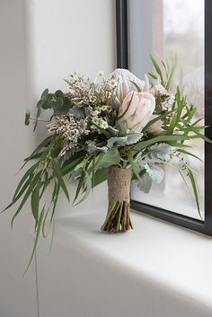 Native bridal bouquet. King protea, gum foliage, silver suede foliage, wax…
