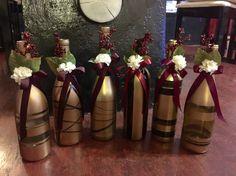 DIY Wedding favors for my wine themed wedding!!! -spray painted wine bottles