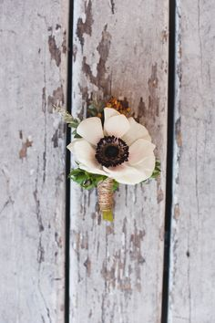 Boutonniere... Making your own can significantly reduce floral costs. Choose a large flower, it will make for an elegant and simple look