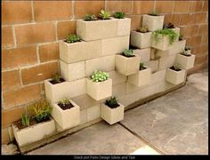 Turn cinder blocks into a miniature garden!  Perfect for small patios.