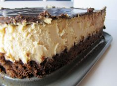 Peanut Butter Cheesecake with a Brownie Crust.. looks amazing!
