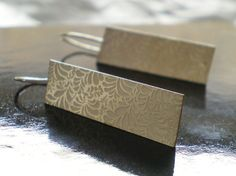 This lovely pair of handmade sterling silver earrings has been photo-etched with a floral pattern.Just simple and elegant for daywear to evening functions.From the Volutes collectionEach piece is truly unique and gives you understated elegance to . Handmade Sterling Silver, Sterling Silver Earrings, Wedding Earrings, Fine Jewelry, Silver Jewellery, Jewels, Gemstones, Diamond, London