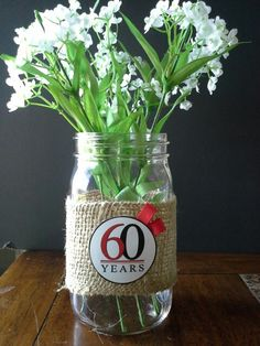 Table decoration for 60th anniversary - burlap and Mason jars