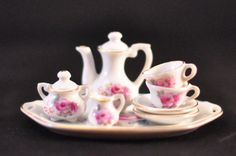 Charming Porcelain Minature Tea Set. $26.00, via Etsy.
