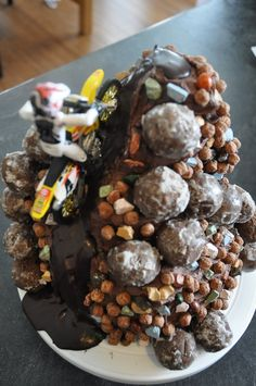 """...chocolate doughnut holes and cocoa puffs and chocolate rocks...The path is made from dark chocolate ganache."""