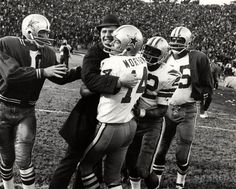 Dallas Cowboys head coach Tom Landry celebrates their 17-10 NFC Championship game victory against the San Francisco 49ers with quarterback #14 Craig Morton, #22 Bob Hayes and #35 Calvin Hill. The victory sent the Cowboys to the Super Bowl for the first time in franchise history.