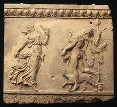 Terracotta plaque, 27 B.C. - A.D. 68, Roman (Augustan or Julio-Claudian era).  Relief with satyr and a maenad.  Metropolitan Museum of Art, New York