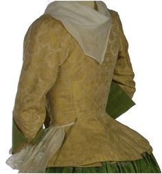 """1720 - 1730. Woman's Silk Jacket and Petticoat. This hand-sewn silk jacket and quilted petticoat lined with linen illustrate the type of informal ensemble worn by women early in the day in the privacy of home. Looking closely at the seams, it is apparent that this jacket is made of several pieces, with set-in sleeves. It is not the """"bedgown"""" type of jacket where the entire body + upper sleeves is a single piece of fabric."""