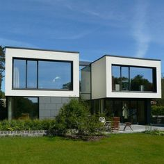 House at Lake Plau by wolff:architekten  This Single Family home was built on a sloping plot at Plauer See, in the northern part of Germany.