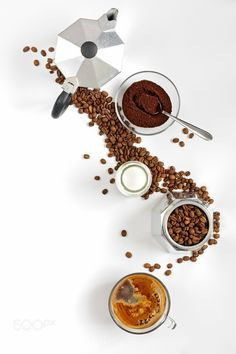 Coffee beans and ground milk in a bottle Moka pot by Belkantus