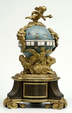 Clock In The Form Of A Celestial Globe Supported On A Circular Plinth, The Hours And Minutes Shown On A Revolving Band, Enameled Gilt-Bronze, With Ebony Plinth Decorated With Boulle Marquetry, And On The Top A Flying Cupid  -  France    c.1720