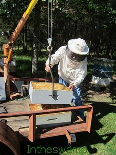 Beehive Lift and Trailer by Intheswamp -- Homemade beehive lift and trailer constructed from a utility trailer and a crane. Powered by an electric winch. http://www.homemadetools.net/homemade-beehive-lift-and-trailer