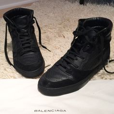 Balenciaga High Tops in black Leather and Suede These are my absolute favorite! I bought them in my size but they run big. I've worn them 1-2 times and sadly they are too big for me. Will fit true size 38.5 - 39. Manufacturer 38 but listing as 38.5. Will ship with original box and dustbag. Balenciaga Shoes