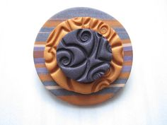 Stamped polymer clay brooch.
