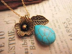 Teardrop Turquoise Stone Necklace adorned with flower and leaf charm. $7.00, via Etsy.