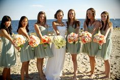 Loving these mint bridesmaid dresses with soft pastel flowers- so feminine and pretty! Tara & Brett: Land's End Long Island Wedding
