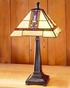 """This Arts and Crafts Stained Glass Table Lamp is 22.5"""" in height with a shade width of 12""""."""