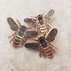 Pins!!! I am so happy to launch my first lapel pins this weekend at @theroyalbison ! Made with rose gold and black enamel these honey bees are limited to 100. Coming soon to online Sunday May 8th (shop.eringreenough.com) by eringreeno