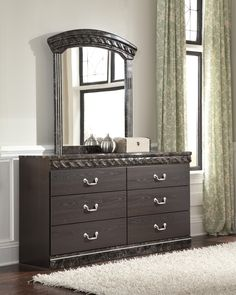 The dresser has luxurious faux-marble and 6 drawers
