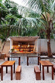 eric werner and mya henry - chef and restaurant owners at their restaurant hartwood - tulum mexico - via the selby