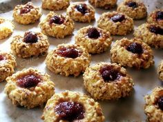 Walnut and jam thumbprint cookies - laura laurentiu Cookie Recipes, Dessert Recipes, Desserts, Jam Thumbprint Cookies, Romanian Food, Cake Shop, Food Cakes, Sweet Cakes, Christmas Baking
