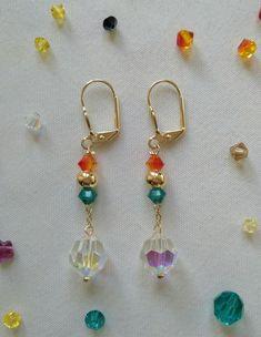Pendientes/aretes largos con cristales de swarovski y material en gold-filled (chapado en oro).