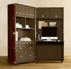 Crafted by antiques dealer and furniture maker Timothy Oulton of London, this steamer trunk armoire is configured as an ingeniously designed secretary.  amazing