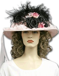"""Just gorgeous. Pink satin Victorian touring hat with black ostrich feathers. Accented with pink and black roses, black beading, on a pink straw hat base. Trimmed with pink tulle, gathered at the back and hangs down approx. 36"""". One size fits all. Hat measures approx. 15"""" across."""