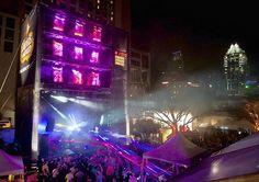 Austin Texas SXSW 2013 Event, Outdoor Lighting, Purple, Blue, Uplighting, Logo Projection Lighting, Stage lighting,  Interactive Lighting, Intelligent Lighting Design, ILD Lighting, Doritos Bold Stage at SXSW 2013 with performances by LL Cool J, Public Enemy, Ice Cube, Doug E Fresh.
