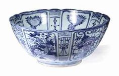 A large Chinese blue and white 'kraak porselein' bowl  Wanli (1573-1619) Decorated to the exterior with lappet-shaped panels enclosing 'antiquities' alternating panels of lotus, peony and chrysanthemum, divided by small tassels, the interior with panels of peach above a roundel enclosing a bird perched on rockwork beside a flowering chrysanthemum, 35.7 cm. diam.