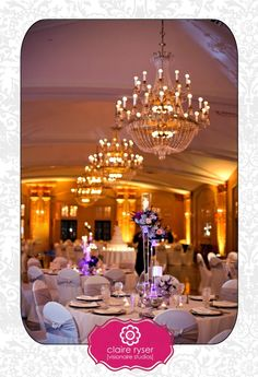 President Hilton - NYE Wedding Reception - Purple Decor Uplighting - Glass Candle sticks - Purple wedding Flowers - Elegant Chair Covers - Gold Silver Reception