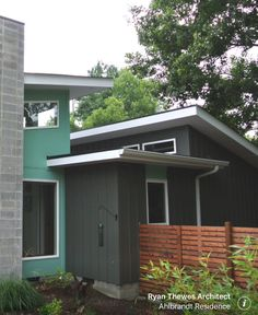 Contemporary colors with modern slat fence