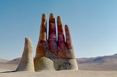 'Mano Del Desierto', Chile - it's a sculpture by artist Mario Irarrazabal. The 36-foot-tall hand was erected in 1992 out of iron and cement; its massive size is meant to emphasize human vulnerability.