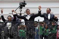 Ecuadorian Vice President Moreno clasps the hand of his president, Rafael Correa, on election night. The most powerful man in a wheelchair? http://www.newmobility.com/articleViewIE.cfm?id=12413