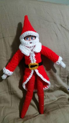 Crochet Santa hat and coat for elf on the shelf. This listing is for 1 Santa hat with beard and 1 coat . ELF DOLL NOT INCLUDED. each item is custom made by me please allow 7 days for the order to be completed. If you need the idem sooner please let me know and I will try to get it