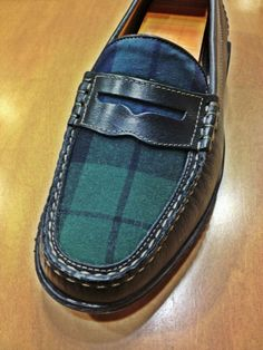 Black watch plaid on a black loafer.