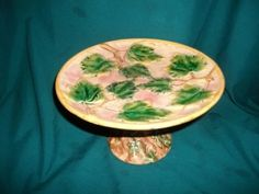 Extraordinary antique majolica pedestal cake stand or cake plate.  It has the Etruscan mark.