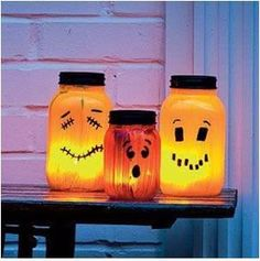 Spray paint mason and or pickle jars. Use sharpie or black paint for facial features. Spray paint sleeve black (or green?) and add candle inside for spooky fun glow.