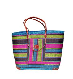 Misa Raffia Basket, Tote, Bag  has a variety of colors that make it easier for people to choose from. It can be used for storage, beach, shopping and outing.  It has both inside and front pocket along with a draw string and leather handles.  Misa is made of Raffia and Straw by the  artisan women from Madagascar, Africa.  Dimensions: 20W x 14H x 10D